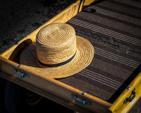 Amish straw hat and pull wagon