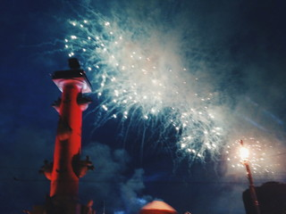 Lighthouse By Firework Display At Night