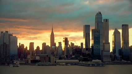 Wall Mural - Midtown Manhattan skyline at sunrise in New York