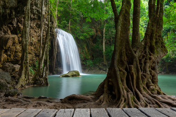 A beautiful waterfall deep in the tropical forest, steep mountain adventure in the rainforest.