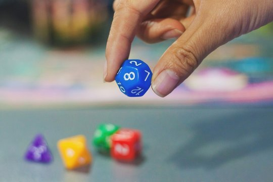 Close-up Of Cropped Hand Holding Dice