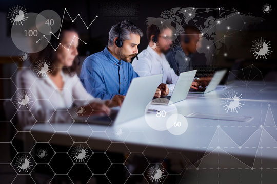 Serious call center operators typing on laptops. Confident support team at workplace with coronavirus virtual charts around. Call center concept