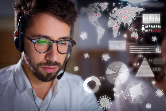 Confident call center operator and virtual disease statistics. Handsome bearded young man sitting at workplace. Call center concept