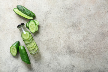 Fotobehang - Bottle of cucumber infused water on table