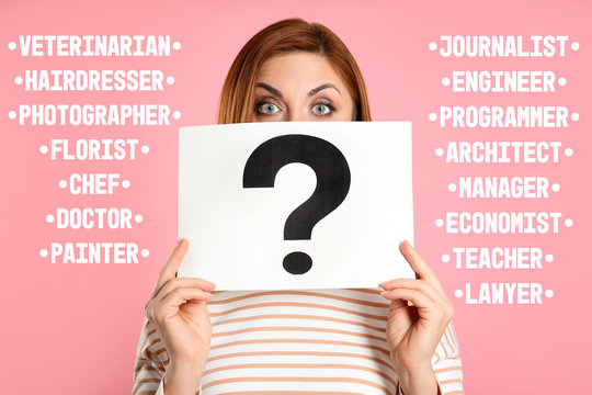 Puzzled woman with question mark sign choosing profession on pink background