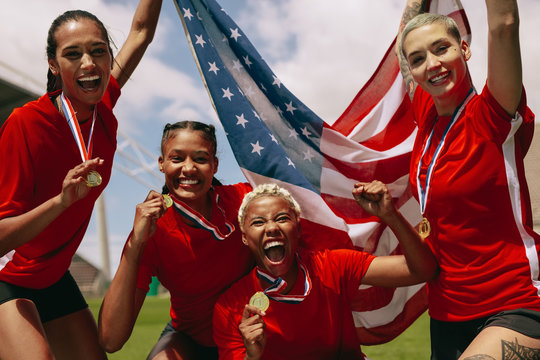 American woman soccer team celebrating championship victory.