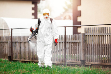 Specialist in hazmat suits cleaning disinfection public garden by service, surface treatment from coronavirus pandemic health risk