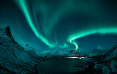 Photo sur Toile Aurore polaire polar lights also called northern lights or aurora borealis in northern norway during winter above a fjord and snow covered mountains