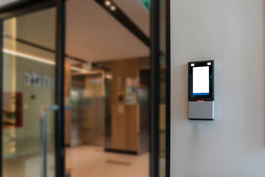 Face scanner on a building entrance wifi system to unlock the door security system. Face scanner for face recognition, password, time recording, work in-out and unlock doors in the office or building.