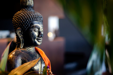 Poster Boeddha buddha statue in interior garden at tropical bar in thailand