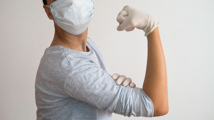 """Nurse with mask and gloves as  Rosie the Riveter """"We Can Do It!""""  Rosie the Riveter."""