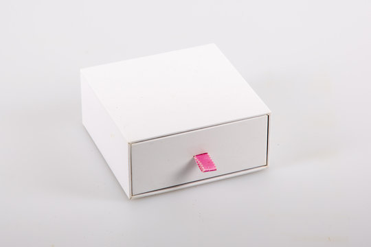white small cardboard sliding box with drawer pink ribbon