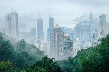 Photo sur Aluminium Hong-Kong Hong Kong city in fog weather viewed from Victoria Peak, a hill on the western half of Hong Kong Island