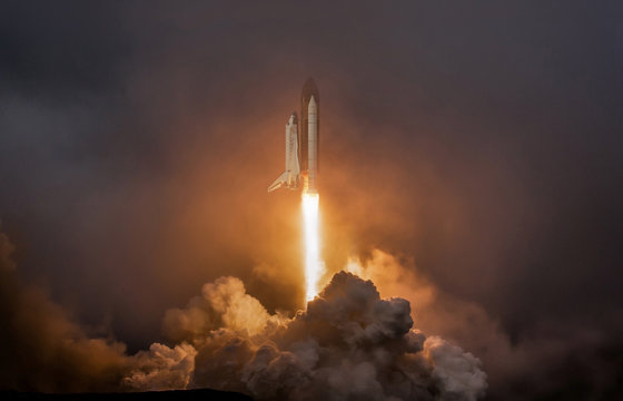 Rocket liftoff. Shuttle spaceship launch in the clouds sky. Spaceship begins the mission. Space shuttle taking off on a mission. Concept space travel to mars