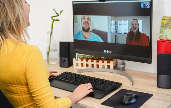 Young woman having a video call with friends during isolation quarantine - Group of people having fun chatting online - Technology and friendship concept - Focus on right hand