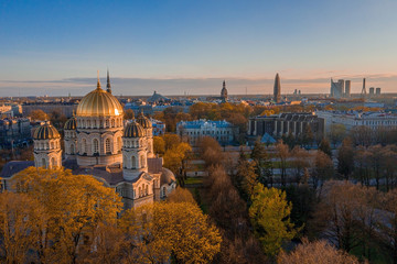 Fotomurales - Aerial top view of Riga Nativity of Christ Cathedral - Famous Church And Landmark of Latvia. Golden Yellow Domes at sunset.