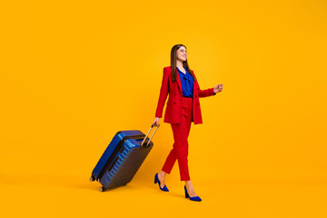 Fototapete - Full size profile photo of attractive business lady walk airport flight registration rolling suitcase wear specs red luxury blazer blouse pants suit shoes isolated yellow color background
