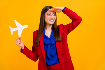 Fototapete - Photo of classy attractive business lady worker hold paper air plane look far away vacation is close wear specs red luxury office blazer blue blouse suit isolated yellow color background