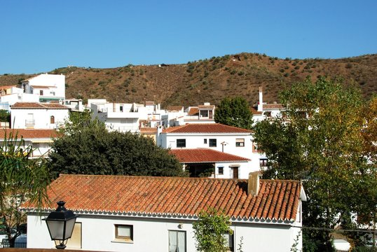 View of town houses in a typical Andalucian pueblo blanco (whitewashed village), Benagalbon, Andalusia, Spain.