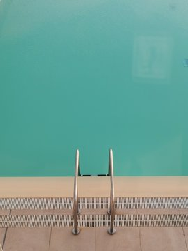 High Angle View Of Ladder In Swimming Pool