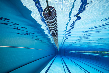 Wall Mural - Olympic Swimming pool under water background.