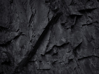 Black and white background. Black rock background. Mountain texture. Close-up. Volumetric stone background.