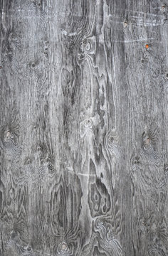Texture of old weathered wood with patterns and scratches