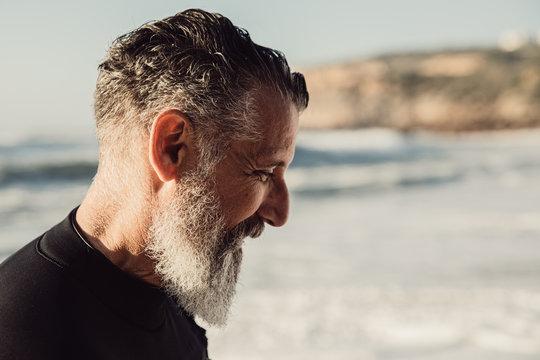 Close up of smiling senior man on beach