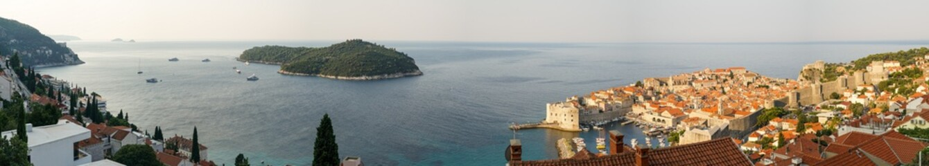 Large panorama of the city of Dubrovnik: southeast, Lokrum island, an old fortress, lit by the rising sun