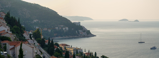 Early morning in the city of Dubrovnik, the city hides behind the mountain from the hot sun, panorama