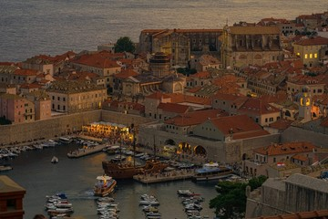 The dying rays of the setting sun gilded the sea and the old city, lights came on