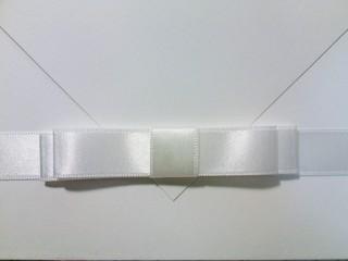 Full Frame Shot Of Wedding Invitation Card With White Ribbon