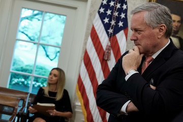 White House staff members Meadows and McEnany attend Trump-Murphy coronavirus response meeting at the White House in Washington