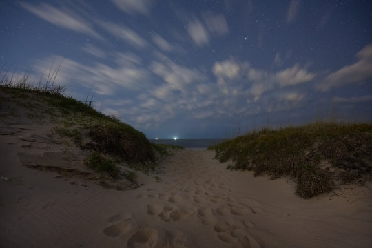 Clouds passing in the nights sky over a beach at Back Bay National Wildlife Refuge