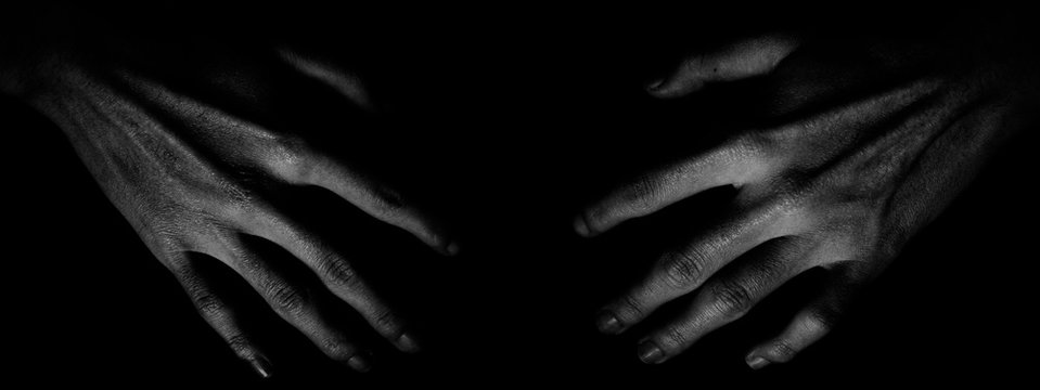 Cropped Image Of Hands On Black Background
