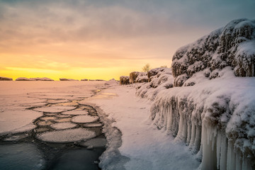 The effect of the polar vortex in the Midwest of Lake Michigan which resulted in frozen waves on the surface of the lake near Chicago, Illinois USA shot at day time.