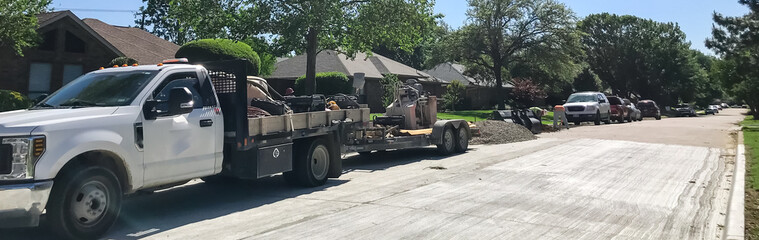 Panoramic construction workers with mask repairing residential sidewalk in suburbs Dallas, Texas, USA