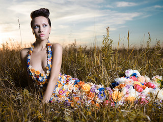 Stores photo womenART Fashion photo of beautiful lady in dress of flowers.