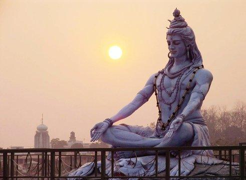 Shiva Statue Against Sky During Sunrise