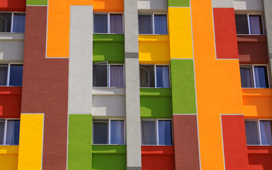 Colored building wall with apartment windows