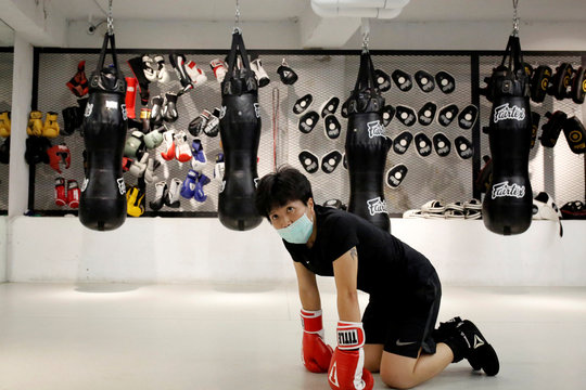 A student of a martial arts center takes a break between trainings while wearing a surgical mask to protect herself from the coronavirus disease (COVID-19) in Taipei