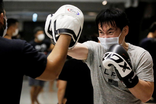 A student of a martial arts center trains while wearing a surgical mask to protect himself from coronavirus disease (COVID-19) in Taipei