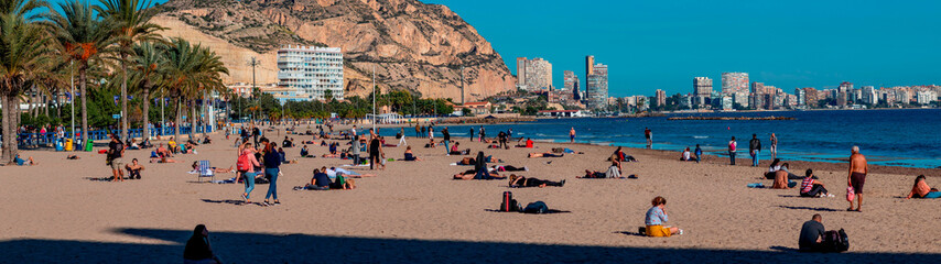 Fototapeten Südeuropa panoramic beach with people in sunny day