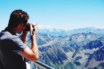 Man Photographing Mountains Against Sky At Pic Du Midi De Bigorre