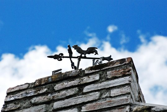 Low Angle View Of Weather Vane On Roof
