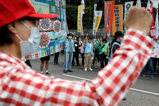 Labour union groups gather for a May Day rally while wearing surgical masks to protect themselves from the coronavirus disease (COVID-19) in Taipei