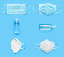 N95 Medical face mask with alcohol sanitizer gel hand wash bottle on blue background covid-19...