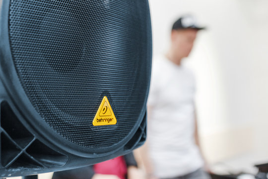 26 February 2018, Ufa, Russia: Behringer subwoofer speaker and blurry DJ at the background