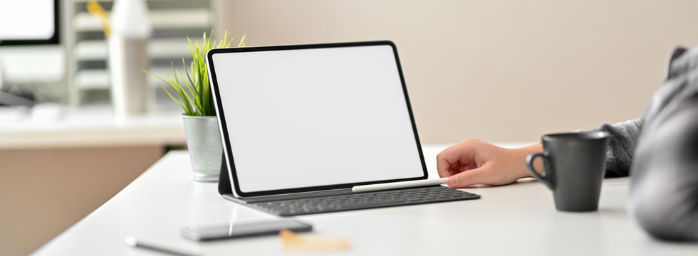 Cropped shot of businessperson reading informations on mock-up tablet