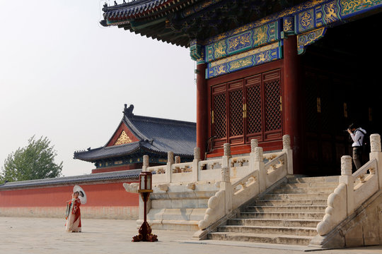 Photographer takes pictures of a model dressed in Hanfu at the Temple of Heaven in Beijing